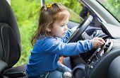 Cute Little Girl Behind Wheel