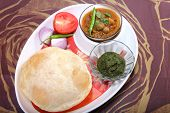 Chole Bhature With Green Chutney And Chili Topping