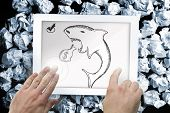 pic of loan-shark  - Composite image of hand touching tablet showing loan shark doodle - JPG