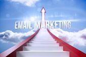 The word email marketing against red steps arrow pointing up against sky