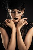 Fashion Model with Black Makeup with veil