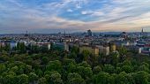 Vienna cityscape at sunset, many different ages, styles and colors