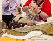 stock photo of matron  - Photo of a elderly woman that spinning wool - JPG