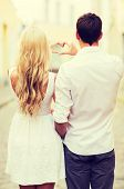 summer holidays, love, travel, tourism, relationship and dating concept - romantic couple in the cit