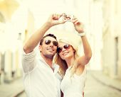 summer holidays, travel, vacation, tourism and dating concept - travelling couple taking photo pictu