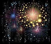 Background with fireworks in the night sky