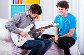 Friends Playing Electric Guitar