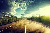 stock photo of sunrise  - road in mountains - JPG