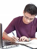 Young Student Doing Assignment