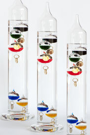 pic of galileo-thermometer  - Three water Galileo thermometers with colorful globes in liquid - JPG