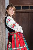 Young woman in traditional Polish costume or dress, a Polish folk costume.