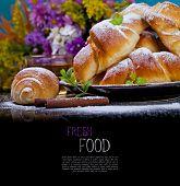Freshly baked croissants on plate for breakfast