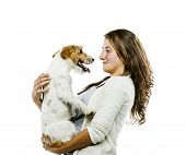 picture of spotted dog  - Young woman holding her cute parson russell terrier dog isolated on white background - JPG