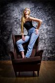 Portrait of young girl on chair