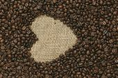 Cafe edition coffee beans heart on Jute background