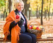 pregnant woman in autumn park