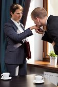 pic of hand kiss  - Elegant businessman kissing woman in the hand - JPG