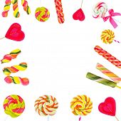 Frame of colorful lollipops isolated on white