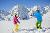 Ski, skier, sun and winter fun - skiers enjoying winter vacations