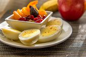 Sliced Hard Boiled Eggs And Fruit Nutricious Breakfast