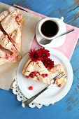 Piece of tasty pie with apples and berry mousse and cup of coffee, on wooden background