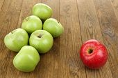 Juicy apples on wooden table