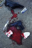 Gun, blood and evidence at crime scene