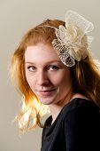 pic of fascinator  - Redhead in black top and cream fascinator - JPG