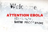 White Wall With Old Advertising And New Text Attention Ebola