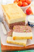 picture of meatloaf  - Beef Meatloaf with Green Peas Topped with Cheesy Mashed Potato - JPG