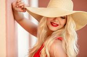 stock photo of big-girls  - Blond girl in a big hat in the summer on a sunny summer day. ** Note: Visible grain at 100%, best at smaller sizes - JPG