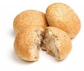 Wholewheat bread rolls or baps on white background.