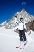 Little boy ready for go to skiing. In background the Matterhorn, Switzerland, Europe.