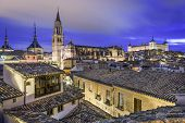 Toledo, Spain town skyline with the Cathedral and Alcazar in the early morning.