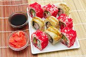 Japanese Rolls On A Plate With Soy Sauce And Pickled Ginger