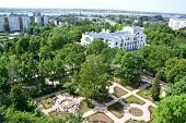 Panoramic view of the park, historical Art Nouveau building and cargo terminal in Riga