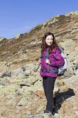 Woman On Mountain Hiking