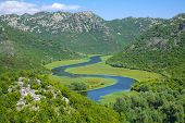 a curvy stretch of Crnojevica River in Skadar Lake National Park, Montenegro