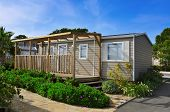 image of nice house  - a nice mobile home with a wooden veranda in a campsite - JPG