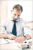 business concept - handsome businessman working in the office