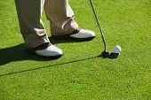 Close-up of man playing golf