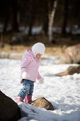 Little girl playing alone outdoors
