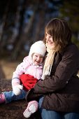 Little girl outdoors with her mother