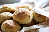 Fresh homemade bread rolls in little basket