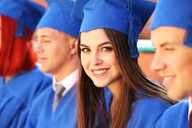 image of graduation gown  - Graduate students wearing graduation hat and gown - JPG