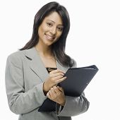 picture of x-files  - Portrait of a businesswoman holding a file - JPG