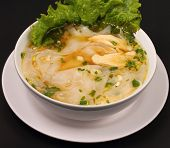 picture of glass noodles  - Glass noodle soup with chicken and beansprouts on a black background - JPG