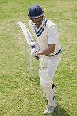 stock photo of cricket shots  - Cricket batsman playing a defensive stroke - JPG
