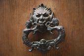 image of messina  - Detail of a door knocker - JPG