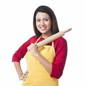image of salwar  - Portrait of a woman holding a rolling pin and smiling - JPG